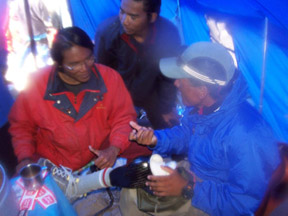 Nawang proudly shows off his high-tech prosthetic leg to other expeditions at Everest Base Camp.